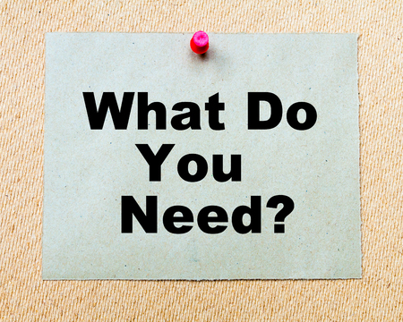 What Do You Need? written on paper note pinned with red thumbtack on wooden board. Business conceptual Image Stock Photo
