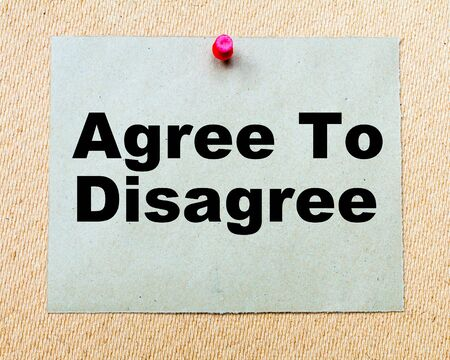 agree: Agree To Disagree written on paper note pinned with red thumbtack on wooden board. Business conceptual Image Stock Photo