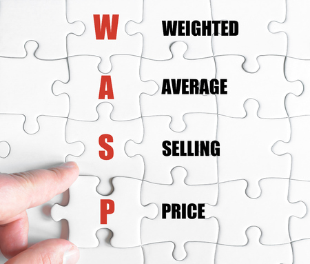weighted: Hand of a business man completing the puzzle with the last missing piece.Concept image of Business Acronym WACC as Weighted Average Selling Price