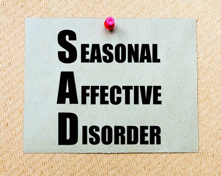 affective: SAD as Seasonal Affective Disorder written on paper note written on paper note pinned with red thumbtack on wooden board. Health conceptual Image Stock Photo
