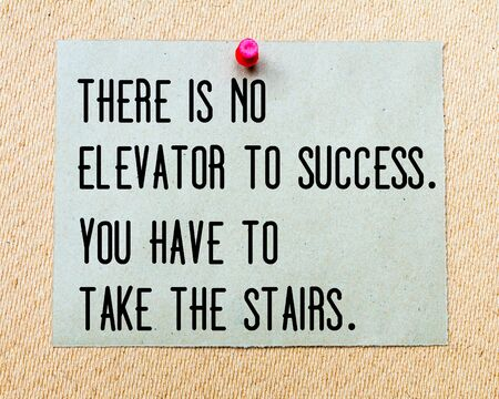 elevator: There is no Elevator To Success, You Have to Take The Stairs written on paper note pinned with red thumbtack on wooden board. Business conceptual Image