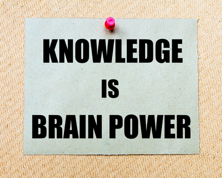 brain power: Knowledge Is Brain Power written on paper note pinned with red thumbtack on wooden board. Motivation conceptual Image Stock Photo