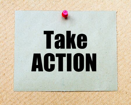 take action: Take Action written on paper note pinned with red thumbtack on wooden board. Motivation conceptual Image Stock Photo