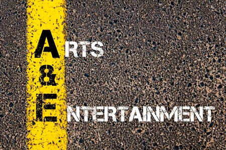 arts and entertainment: Concept image of Business Acronym AE as Arts And Entertainment written over road marking yellow paint line.