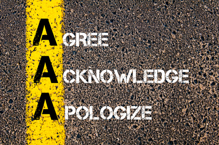 apologize: Concept image of Business Acronym AAA as Agree Acknowledge Apologize written over road marking yellow paint line.