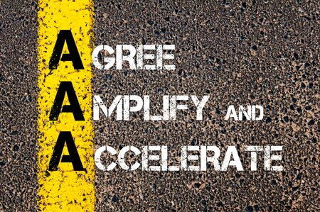 agree: Concept image of Business Acronym AAA as Agree Amplify and Accelerate written over road marking yellow paint line.