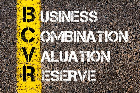 valuation: Concept image of Business Acronym BCVR as Business Combination Valuation Reserve written over road marking yellow paint line.