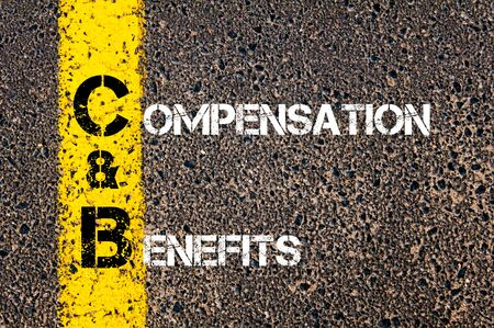 cb: Concept image of Business Acronym C&B as Compensation and Benefits  written over road marking yellow paint line.