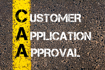 Concept image of Business Acronym CAA as Customer Application Approval  written over road marking yellow paint line.