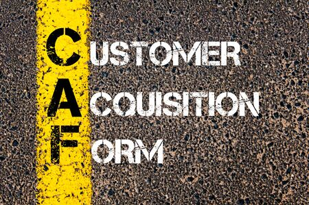 caf: Concept image of Business Acronym CAF as Customer Acquisition Form  written over road marking yellow paint line.
