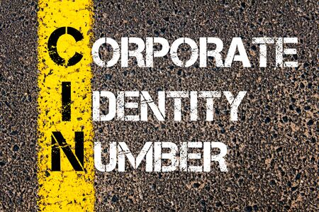 cin: Concept image of Business Acronym CIN as Corporate Identity Number  written over road marking yellow paint line.