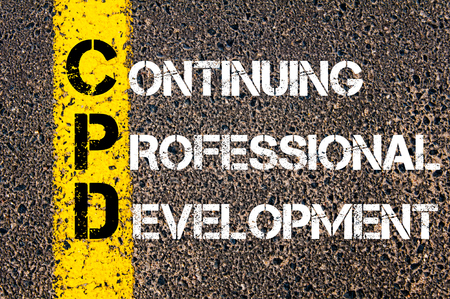 Concept beeld van bedrijf Acroniem CPD als Continuing Professional Development overschreven wegmarkering gele verf lijn.