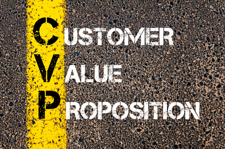 proposition: Concept image of Business Acronym CVP as Customer Value Proposition written over road marking yellow paint line. Stock Photo