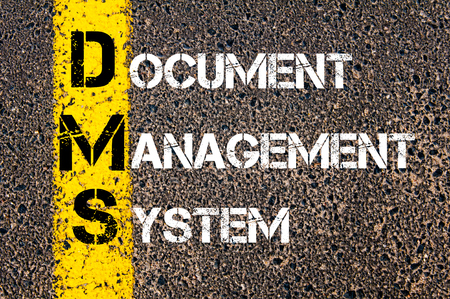 dms: Concept image of Business Acronym DMS as Document Management System written over road marking yellow paint line. Stock Photo
