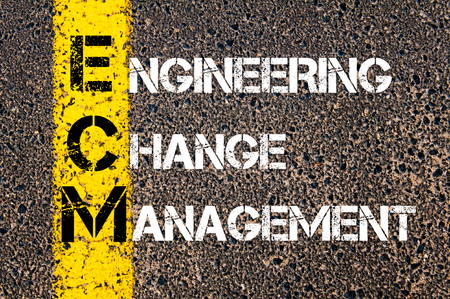 ecm: Concept image of Business Acronym ECM as Engineering Change Management written over road marking yellow paint line. Stock Photo