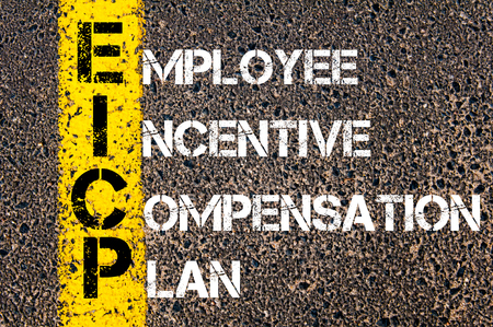 Concept image of Business Acronym EICP as Employee Incentive Compensation Plan  written over road marking yellow paint line.