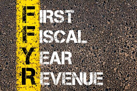 fiscal: Concept image of Business Acronym FFYR as First Fiscal Year Revenue written over road marking yellow paint line.