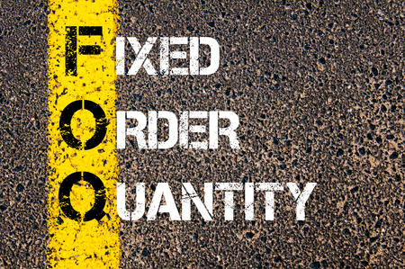 fixed line: Concept image of Business Acronym FOQ as Fixed Order Quantity written over road marking yellow paint line.