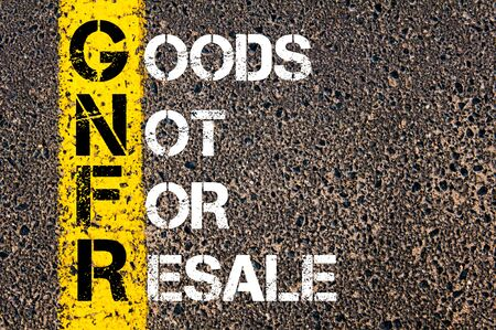 resale: Concept image of Business Acronym GNFR as Goods Not For Resale written over road marking yellow paint line. Stock Photo