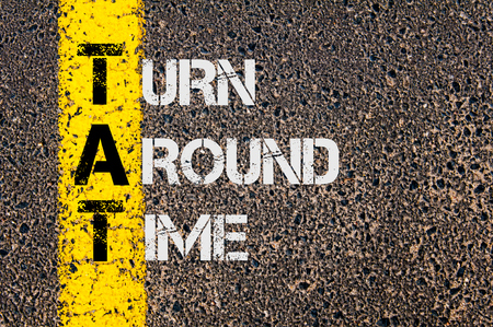 tat: Concept image of Business Acronym TAT as Turn Around Time written over road marking yellow painted line.