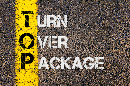 turn over: Concept image of Business Acronym TOP as Turn Over Package written over road marking yellow painted line. Stock Photo