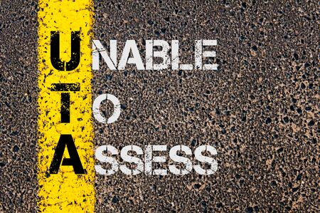 to assess: Concept image of Business Acronym UTA as Unable To Assess written over road marking yellow painted line.