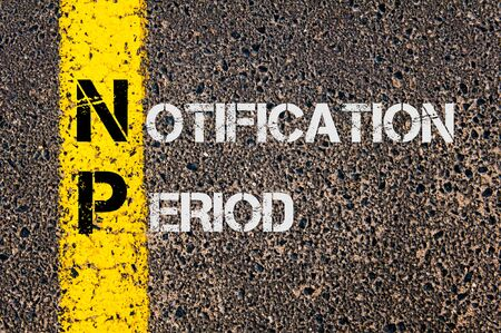 np: Concept image of Business Acronym NP as Notification Period written over road marking yellow painted line. Stock Photo