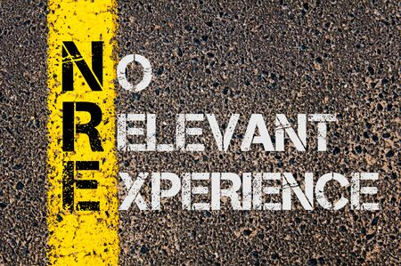 relevant: Concept image of Business Acronym NRE as No Relevant Experience written over road marking yellow painted line.