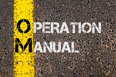 road marking: Concept image of Business Acronym OM as Operation Manual written over road marking yellow painted line.