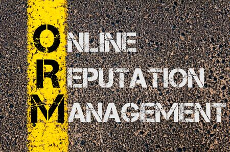 Concept image of Business Acronym ORM as Online Reputation Management written over road marking yellow painted line. Stock Photo