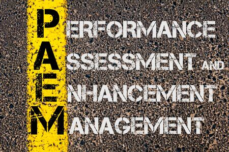 enhancement: Concept image of Business Acronym PAEM as Performance Assessment and Enhancement Management written over road marking yellow painted line.