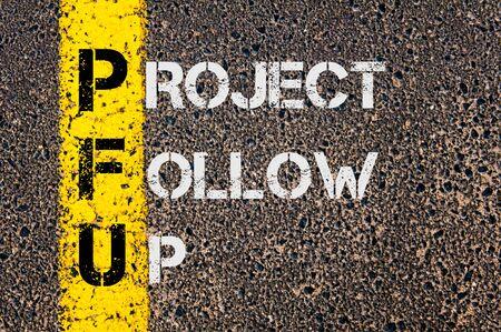 marking up: Imagen del concepto del acr�nimo UFP negocios como Proyecto de Seguimiento escrito sobre marcaje l�nea pintada amarilla carretera.