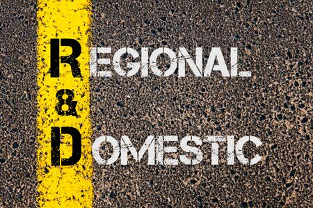 rd: Concept image of Business Acronym R&D as Regional and Domestic written over road marking yellow painted line. Stock Photo