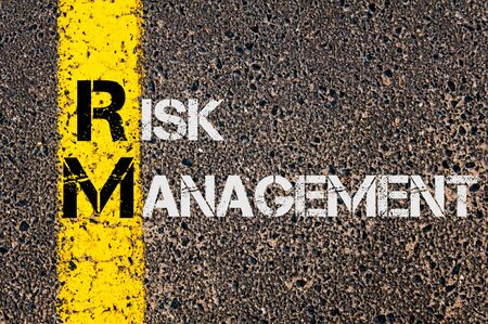 Concept image of Business Acronym RM as Risk Management written over road marking yellow painted line.