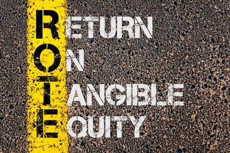 rote: Concept image of Business Acronym ROTE as Return On Tangible Equity written over road marking yellow painted line. Stock Photo