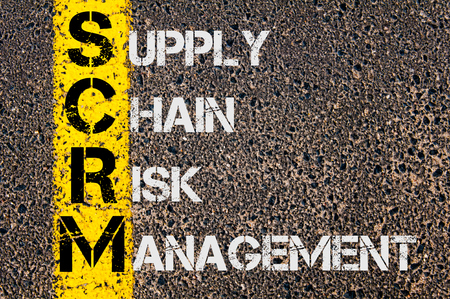 supply chain: Concept image of Business Acronym  SCRM as Supply Chain Risk Management written over road marking yellow paint line. Stock Photo