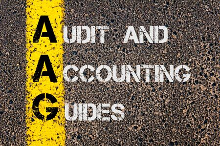 guides: Concept image of Business Acronym AAG as Audit and Accounting Guides  written over road marking yellow paint line. Stock Photo