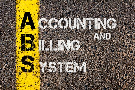 billing: Concept image of Business Acronym ABS as Accounting and Billing System written over road marking yellow paint line.