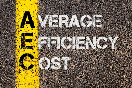 aec: Concept image of Business Acronym AEC as Average Efficiency Cost  written over road marking yellow paint line. Stock Photo