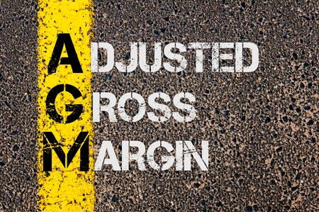 adjusted: Concept image of Business Acronym AGM as Adjusted Gross Margin  written over road marking yellow paint line.
