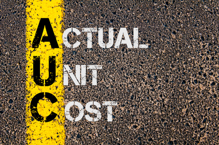 actual: Concept image of Business Acronym AUC as Actual Unit Cost  written over road marking yellow paint line. Stock Photo
