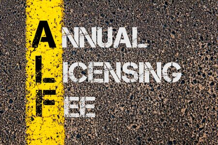 afl: Concept image of Business Acronym AFL as Annual Licensing Fee  written over road marking yellow paint line. Stock Photo