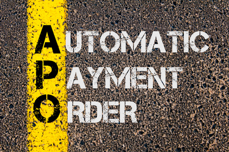 apo: Concept image of Business Acronym APO as Automatic Payment Order  written over road marking yellow paint line.