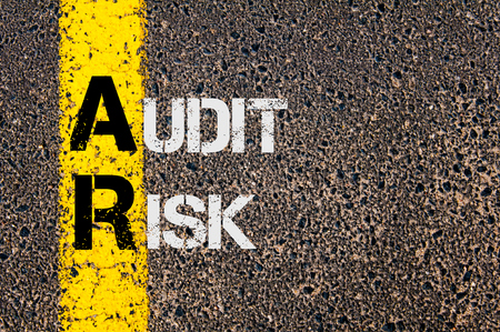 ar: Concept image of Business Acronym AR as Audit Risk  written over road marking yellow paint line. Stock Photo