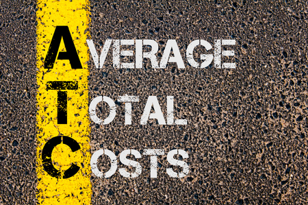 atc: Concept image of Business Acronym ATC as Average Total Costs  written over road marking yellow paint line. Stock Photo
