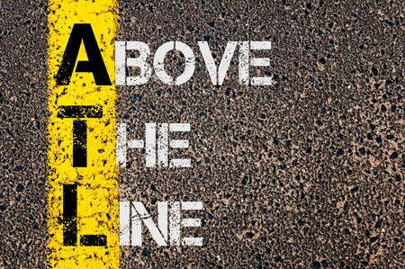 Concept image of Business Acronym ATL as Above The Line  written over road marking yellow paint line.