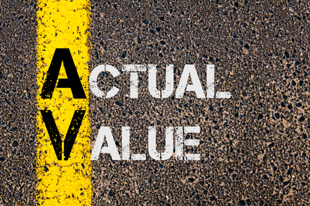 actual: Concept image of AV as Actual Value  written over road marking yellow paint line.