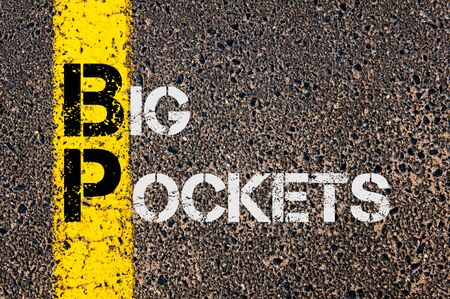 bp: Concept image of Business Acronym BP as Big Pockets  written over road marking yellow paint line.