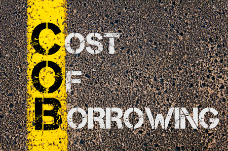 borrowing: Concept image of Business Acronym COB as Cost Of Borrowing  written over road marking yellow paint line.