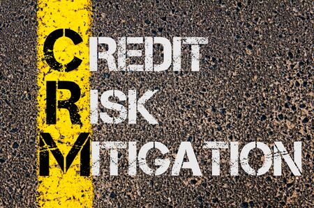 mitigation: Concept image of Business Acronym CRM  as Credit Risk Mitigation  written over road marking yellow paint line.